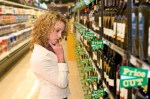millennial selecting wine at Safeway